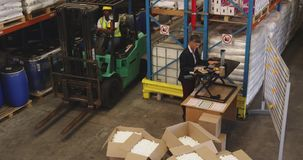 Female warehouse manager working standing at a desk 4k stock video footage