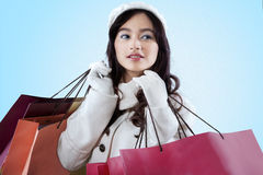 Female in warm clothes with shopping bags Stock Photography