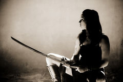 Female warrior. Female gothic warrior posing with katana sword Royalty Free Stock Images