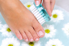 Female washes and cleans the toenails Royalty Free Stock Photography