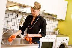 Female Washing Tomatoes Royalty Free Stock Photo