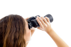 Female watching through binocular Stock Photography