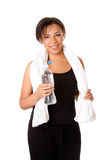 Female with water after workout. Beautiful attractive happy young sweaty woman with water after exercise workout, rehydrating thirst quenching, isolated Royalty Free Stock Photography