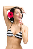 Female wearing bikini and flower in hair Stock Images