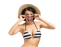 Female wearing bikini, hat and sunglasses Stock Photography
