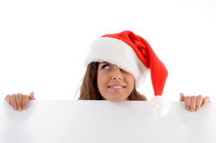 Female wearing christmas hat and holding placard Stock Images