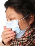 Female wearing Face mask Stock Images