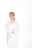 Female Wearing Lab Coat While Holding Clipboard Royalty Free Stock Photography