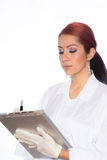 Female Wearing Lab Coat While Holding Clipboard Royalty Free Stock Image