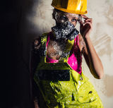 Female wearing a respirator posing indoors Stock Photography