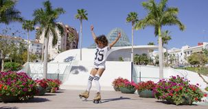 Female wearing rollerskates riding in park stock video footage