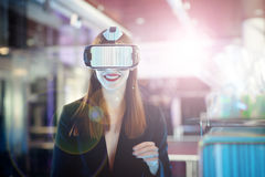 Female wearing virtual reality glasses. Smiling female wearing virtual reality glasses on party background Stock Images
