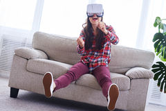 Female wearing VR glasses driving car in virtual reality Royalty Free Stock Image