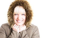 Female wearing winter jacket with hood being cold Stock Photos