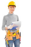 Female wearing working clothes and construction tools holding cl Stock Photos