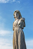 Female weathered statue in graveyard Royalty Free Stock Photo