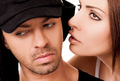 Female whispering to man. Close-up of beautiful female whispering to a men's ear Stock Photo