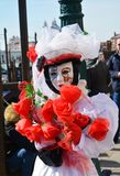 Female white mask and dress, Venice, Italy, Europe Royalty Free Stock Image