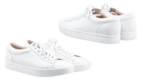 Female white sneakers. Isolated white background Stock Image
