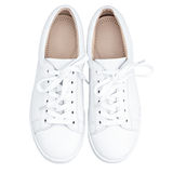 Female white sneakers. Isolated white background Royalty Free Stock Photography