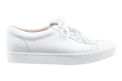 Female white sneakers. Isolated white background Royalty Free Stock Photos