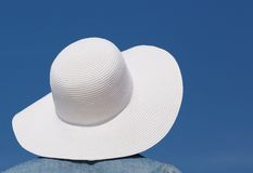 Female with white sun hat Stock Image