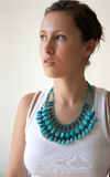 Female in white top and turquoise necklace Royalty Free Stock Photography