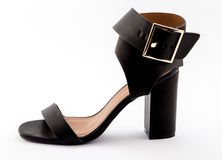 Female wide strapped black high heel sandal isolated on white Stock Images