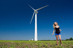 Female at wind power generator Stock Image