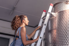 Female winemaker controls the quality of wine Royalty Free Stock Photography