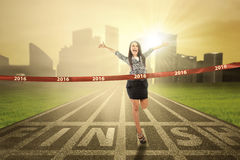 Female winner crossing the finish line Stock Photography