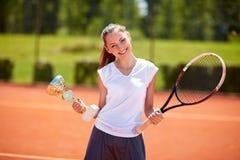 Female winner in tennis match Stock Photo