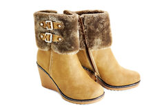 Female winter boots. Women's winter boots with fur and thongs Royalty Free Stock Image