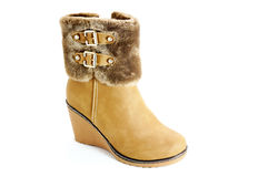 Female winter boots. Women's winter boots with fur and thongs Royalty Free Stock Images