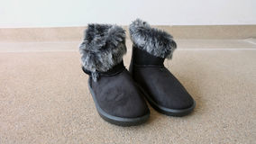 Female Winter Fur Boots or Shoes On The Concrete Floor Background Royalty Free Stock Photo