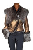 Female winter jacket. Of gold color decorated by fur Royalty Free Stock Photography