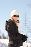 Female in winter sunshine Royalty Free Stock Photography