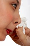 Female wiping her nose Royalty Free Stock Images