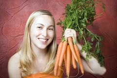 Female With Carrots Royalty Free Stock Photos