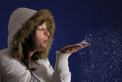Female woman blowing snow Royalty Free Stock Photos