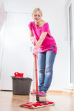Female Woman Cleaning Home. Female cleaning and mopping floor at home Royalty Free Stock Photography