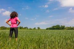 Female Woman Girl Runner in Green Field Stock Image