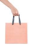 A female(woman) hand hold a pink shopping bag(paper bag) at the Royalty Free Stock Images