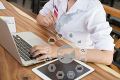Female woman holding a credit card and using laptop computer for Stock Image