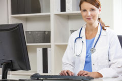 Female Woman Hospital Doctor Using Computer. Woman female medical doctor using computer in her hospital office Stock Image