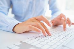 Female woman office worker typing on the keyboard. Female hands or woman office worker typing on the keyboard Royalty Free Stock Image
