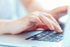 Female woman office worker typing on the keyboard Stock Photo