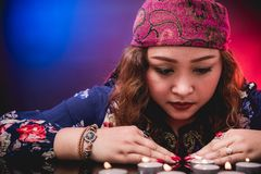 Female woman seer teller psychic fortuneteller. Predicting fate for sign stock photo