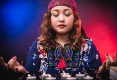 Female woman seer teller psychic fortuneteller. Predicting fate for sign Stock Photos
