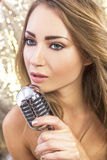 Female Woman Singing With Vintage Microphone Stock Photo